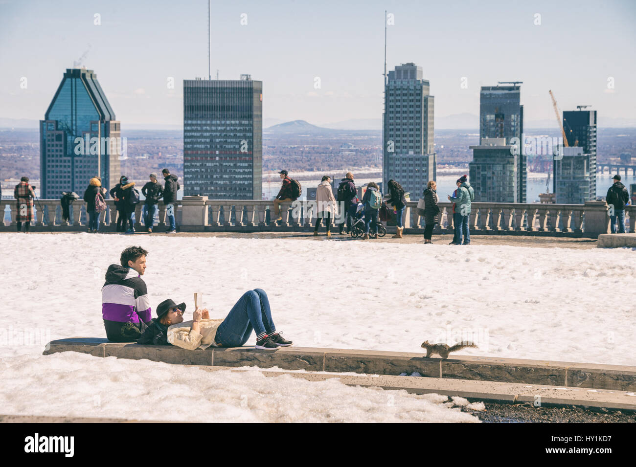Montreal, CA - 30 March 2017: People enjoying a sunny spring day on Kondiaronk Belvedere Stock Photo