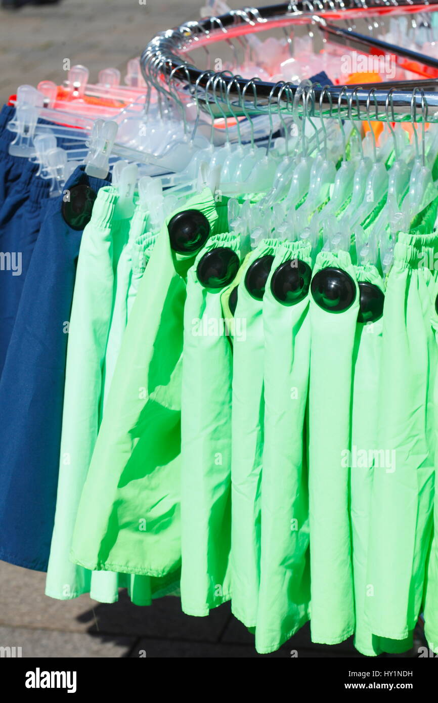Swim Trunks on a clothes rail - Stock Image