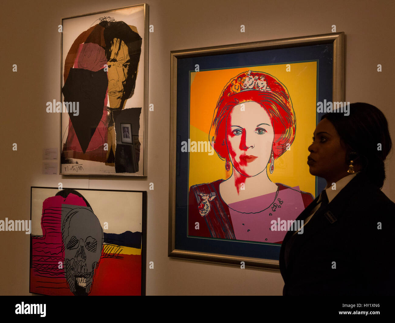 London, UK. 31 March 2017. Andy Warhol prints of Queen Beatrix, Mick Jagger and a Skull. Auction house Sotheby's - Stock Image