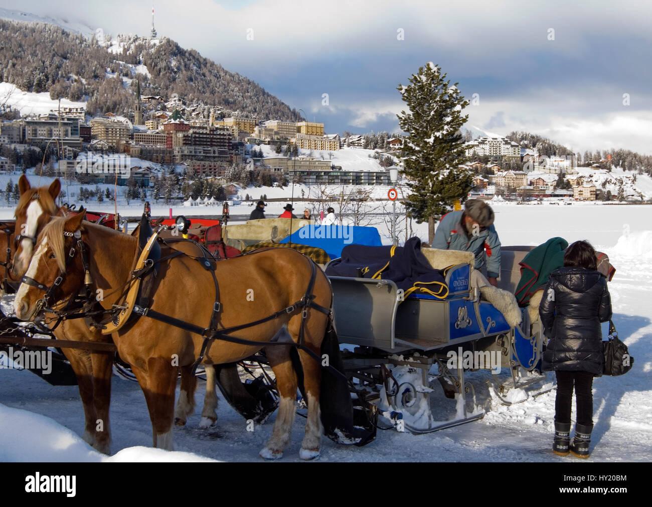 Sleigh at Lake St.Moritz against a panorama of St.Moritz, Switzerland Stock Photo