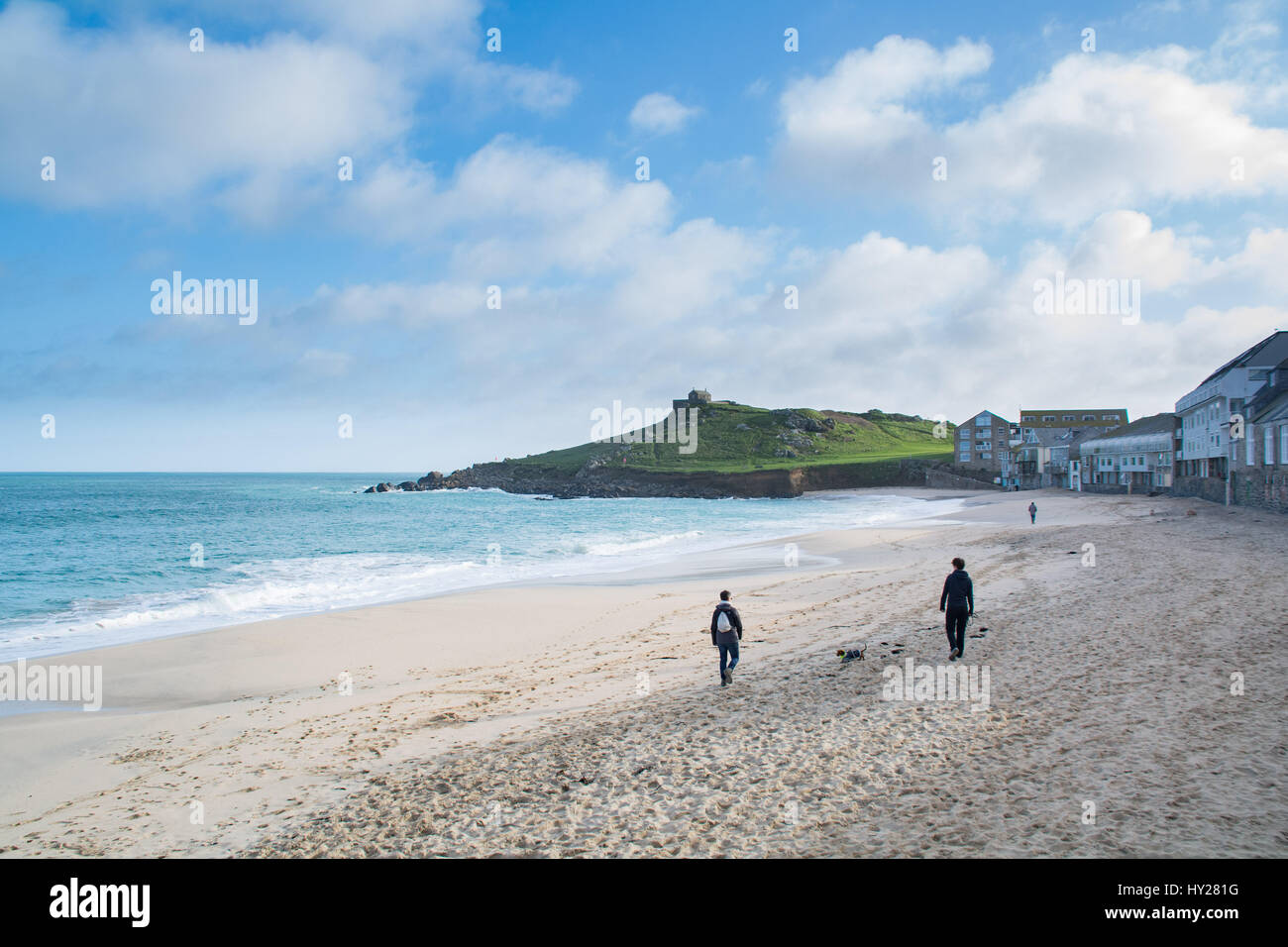 St Ives, Cornwall, UK. 31st March 2017. UK Weather. Sunny morning and great surf conditions at St Ives this morning. - Stock Image