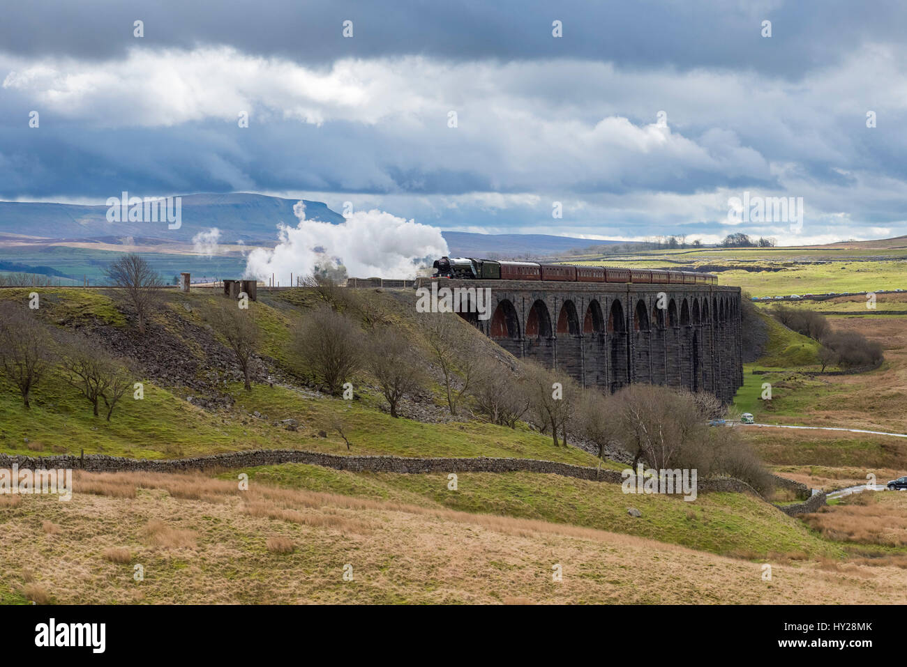 Ribblehead, North Yorkshire, UK. 31st March 2017. The iconic steam locomotive LNER class A3 60103 Flying Scotsman, - Stock Image