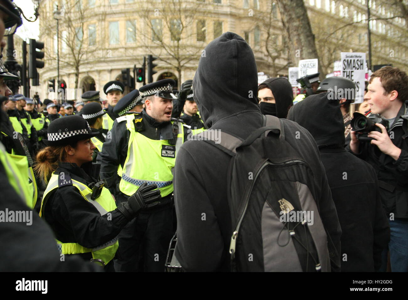 London, UK. April 1st, 2017. Police confront anti-racist protesters. Far right groups Britain First and the English - Stock Image