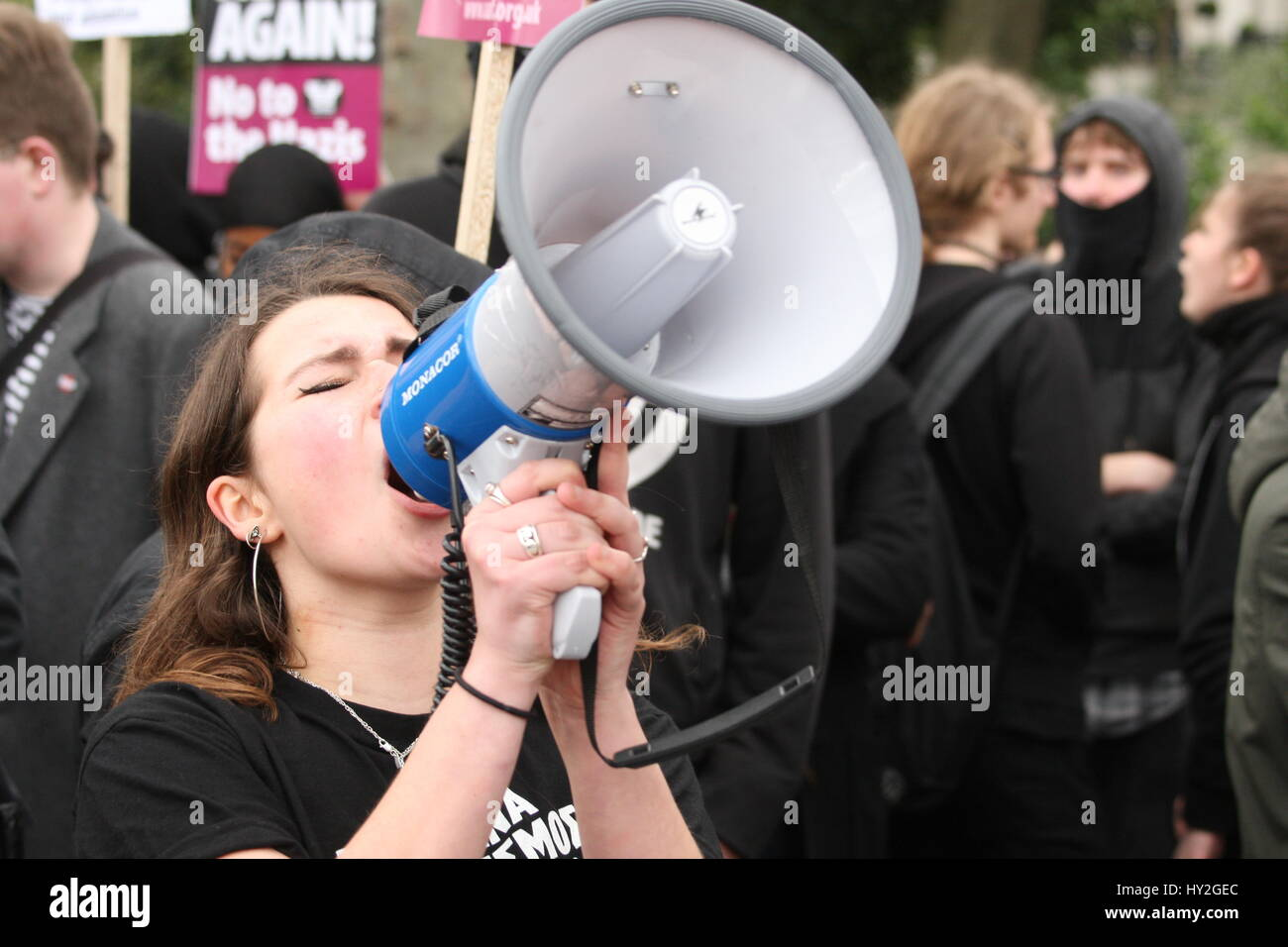 London, UK. April 1st, 2017. A woman chants antyi-racism slogans. Far Right Groups Britain First and the English - Stock Image