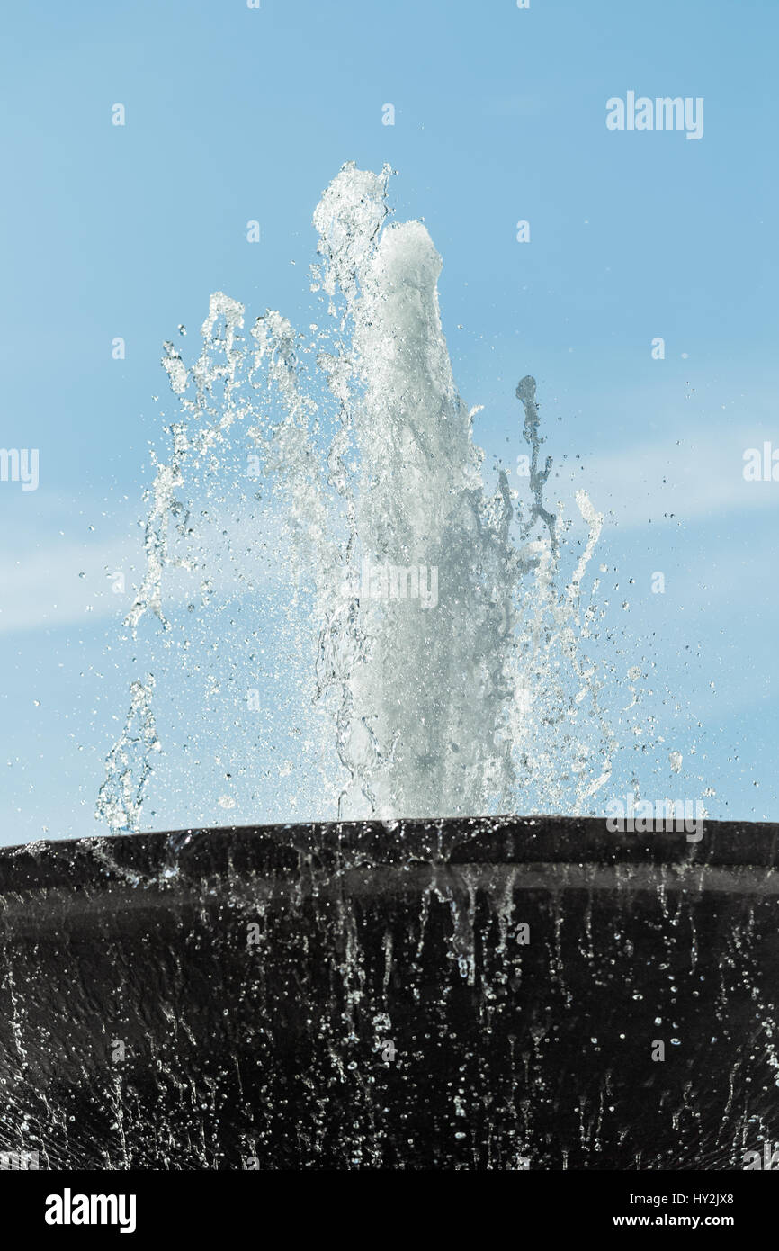 Jet of water from a fountain at Trafalgar Square, London, England. - Stock Image