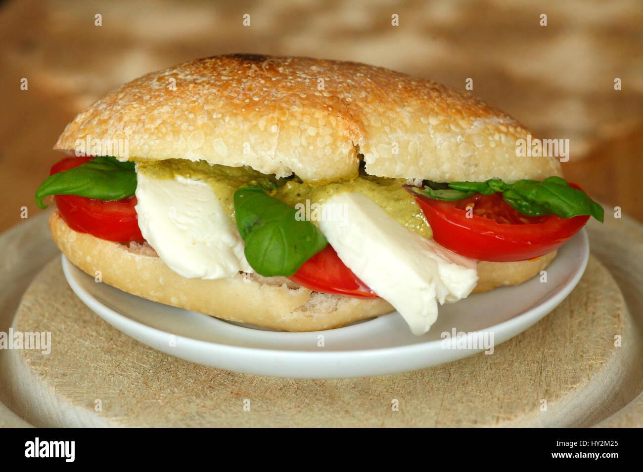 Ciabatta Bread Sandwich with Tomatoes and Mozzarella Chese - Stock Image