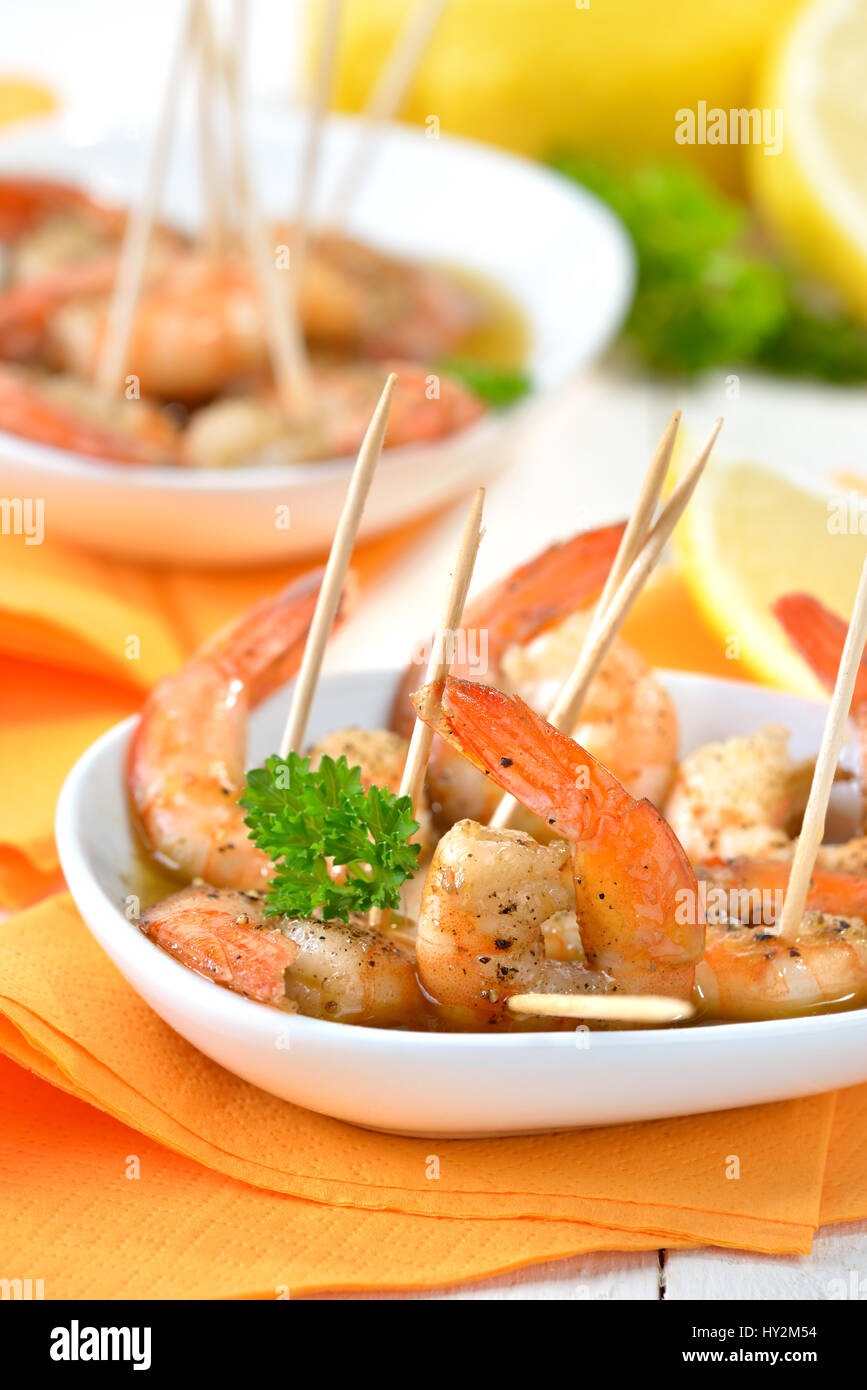 Spanish tapas - fried spicy prawns with olive oil, Sherry and garlic - Stock Image