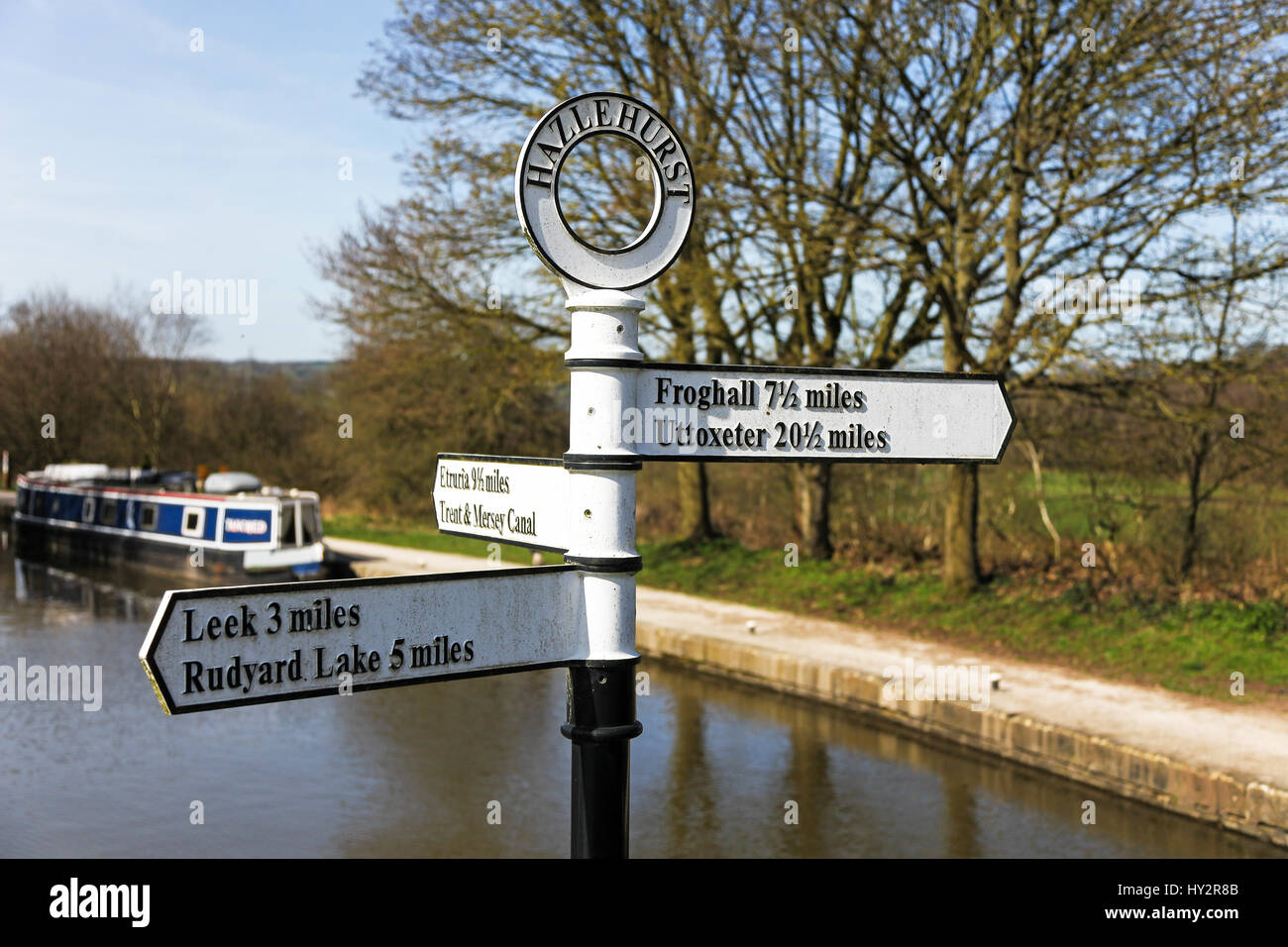 A sign post at the junction of the Leek branch of the Caldon Canal at Hazelhurst locks Denford Staffordshire England - Stock Image