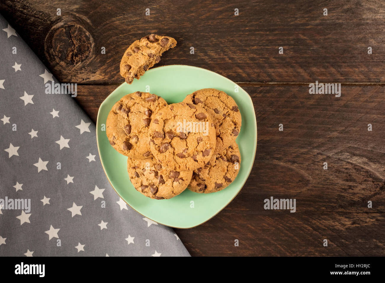 Plate of chocolate chips cookies, shot from above - Stock Image