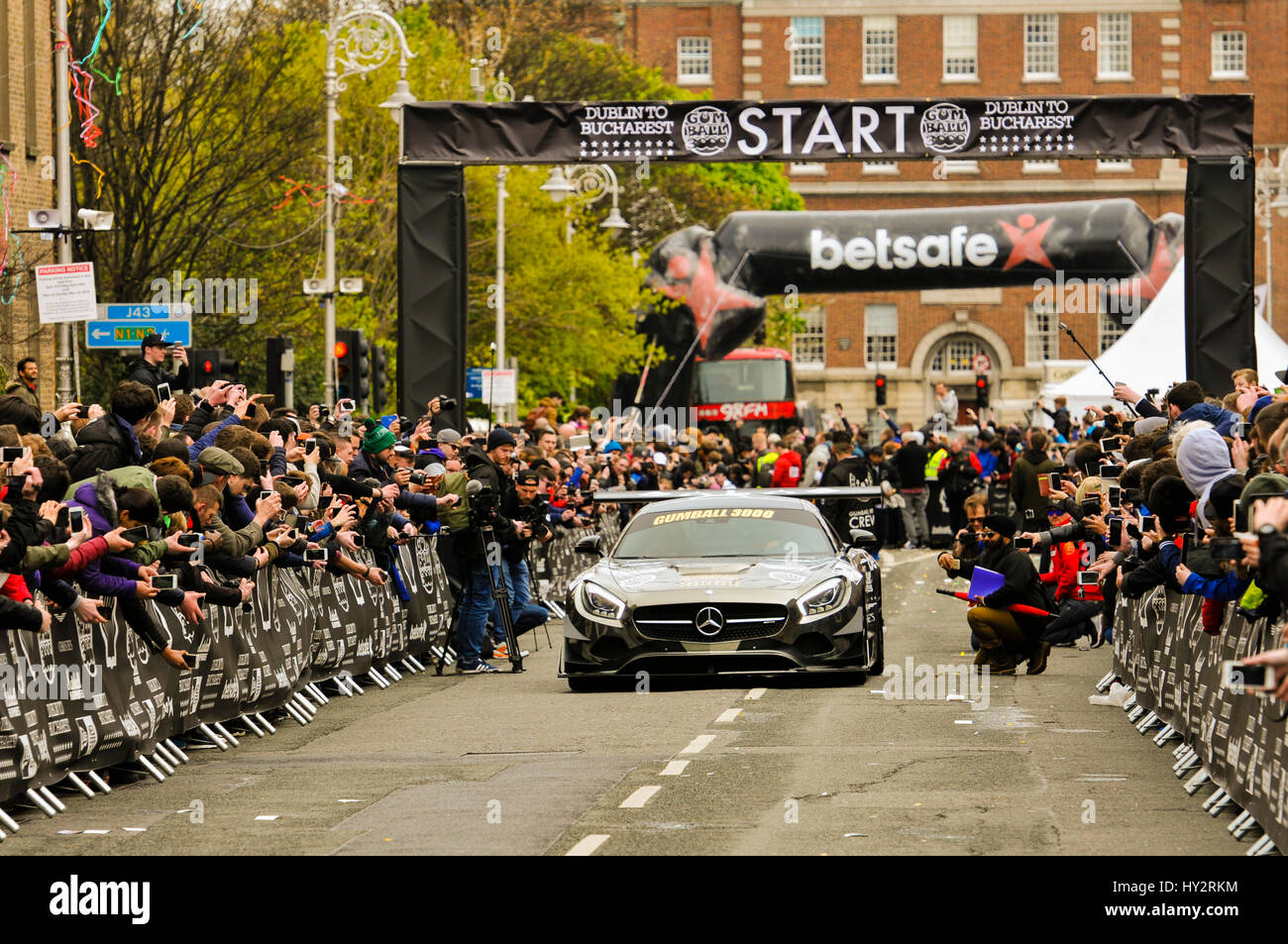 DUBLIN, IRELAND. MAY 01 2016 - A Mercedes SL Black Edition roars off from Dublin on the first leg of the Gumball - Stock Image