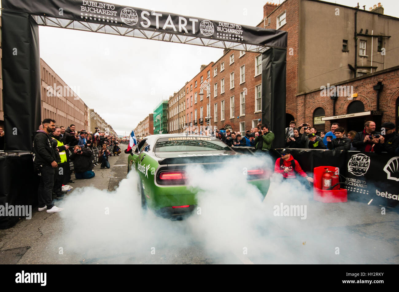 DUBLIN, IRELAND. MAY 01 2016 - A Dodge Charger generates a lot of smoke as is leaves Dublin on the first leg of - Stock Image