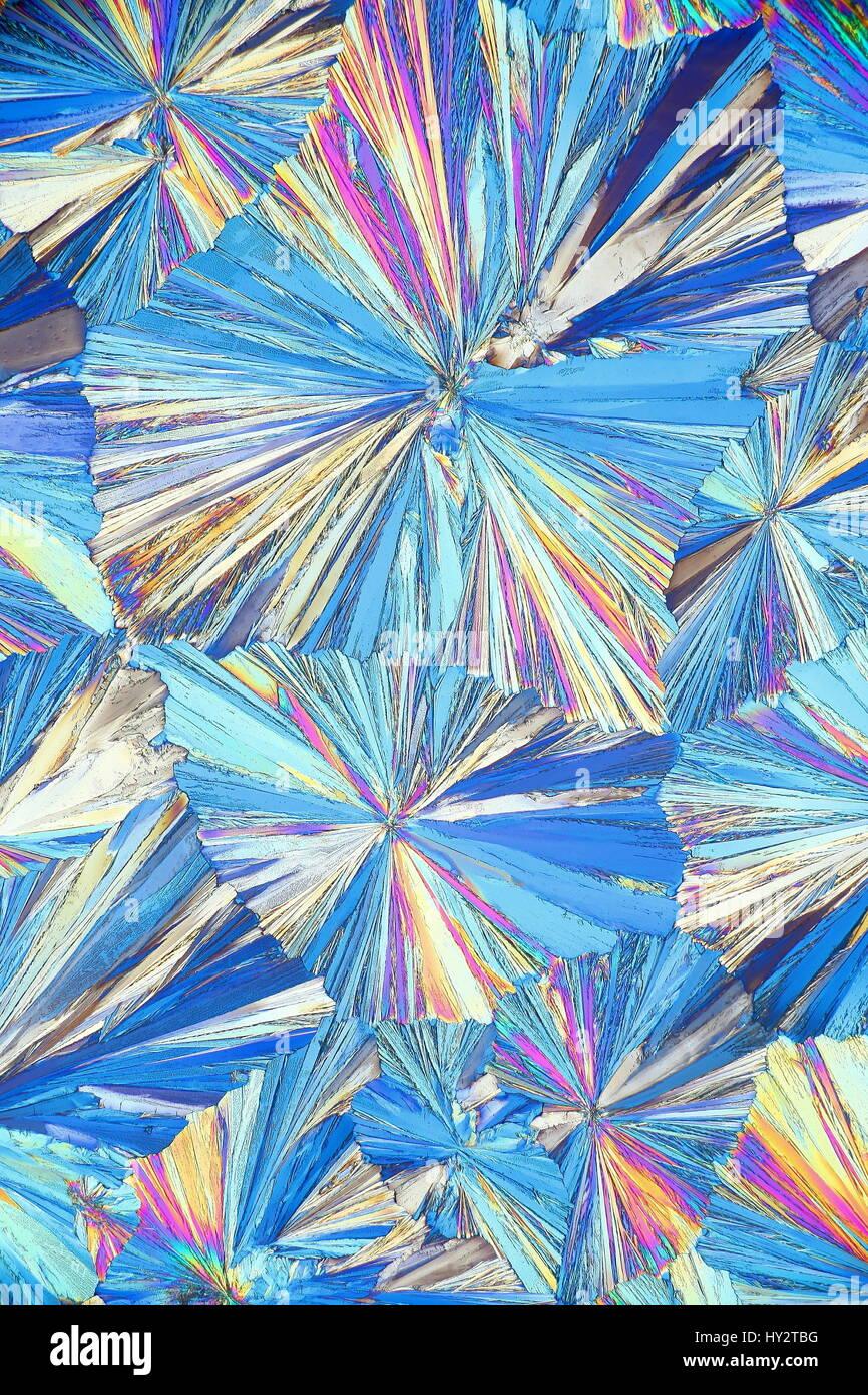 Microscope image of crystals of Asipirin (acetylsalicylic acid) photographed in polarized light - Stock Image