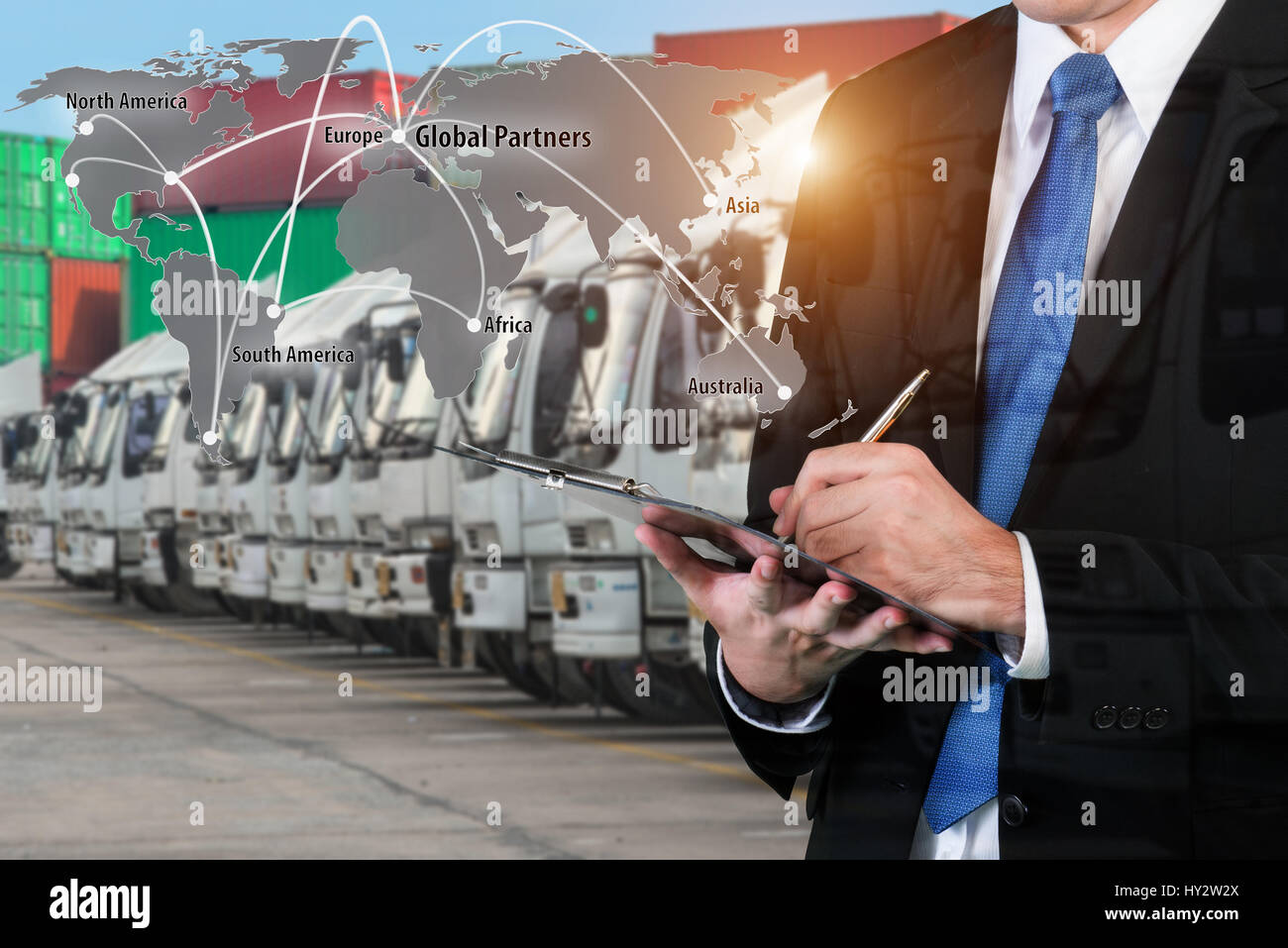 Double exposure of businessman is booking with blurred cargo , transportation port and world map. Transportation - Stock Image