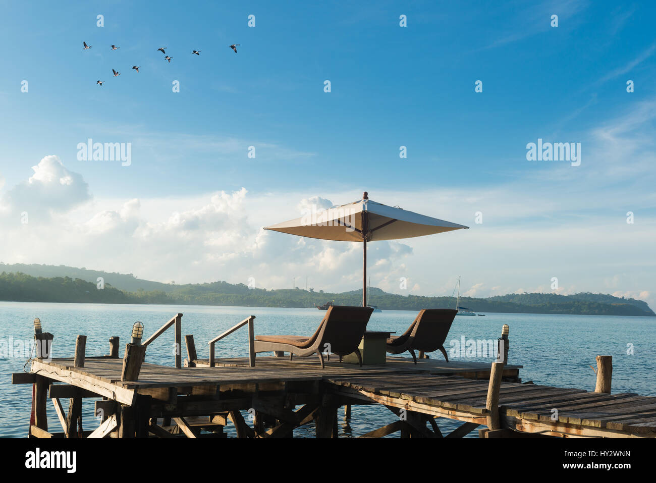 Beach Chairs and Umbrella on island in Phuket, Thailand. Summer, Travel, Vacation and Holiday concept - Stock Image