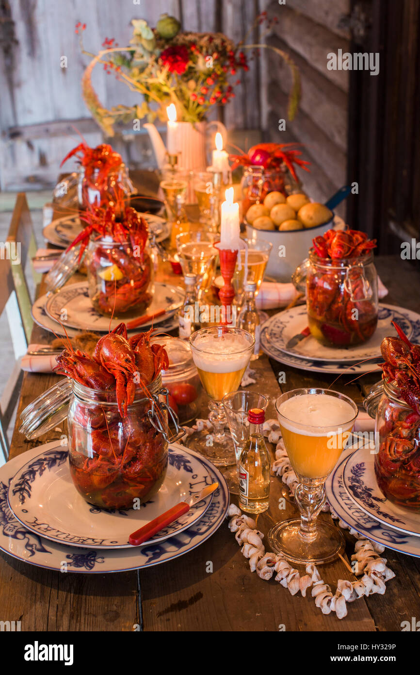 Sweden, Fresh crayfish on wooden table - Stock Image