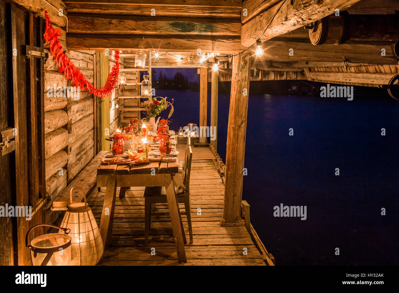 Sweden, Patio with fresh crayfish on wooden table - Stock Image