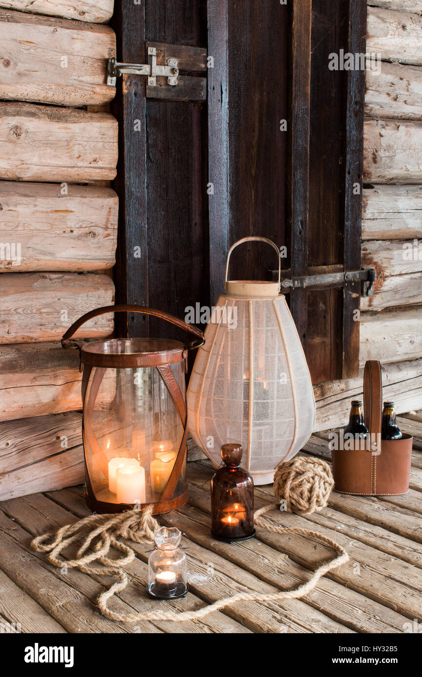 Sweden, Wooden patio with candles and lanterns - Stock Image