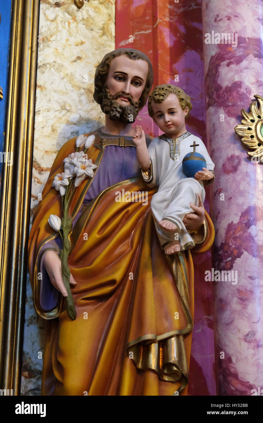 Saint joseph holding baby jesus statue at the altar in the - Child jesus images download ...