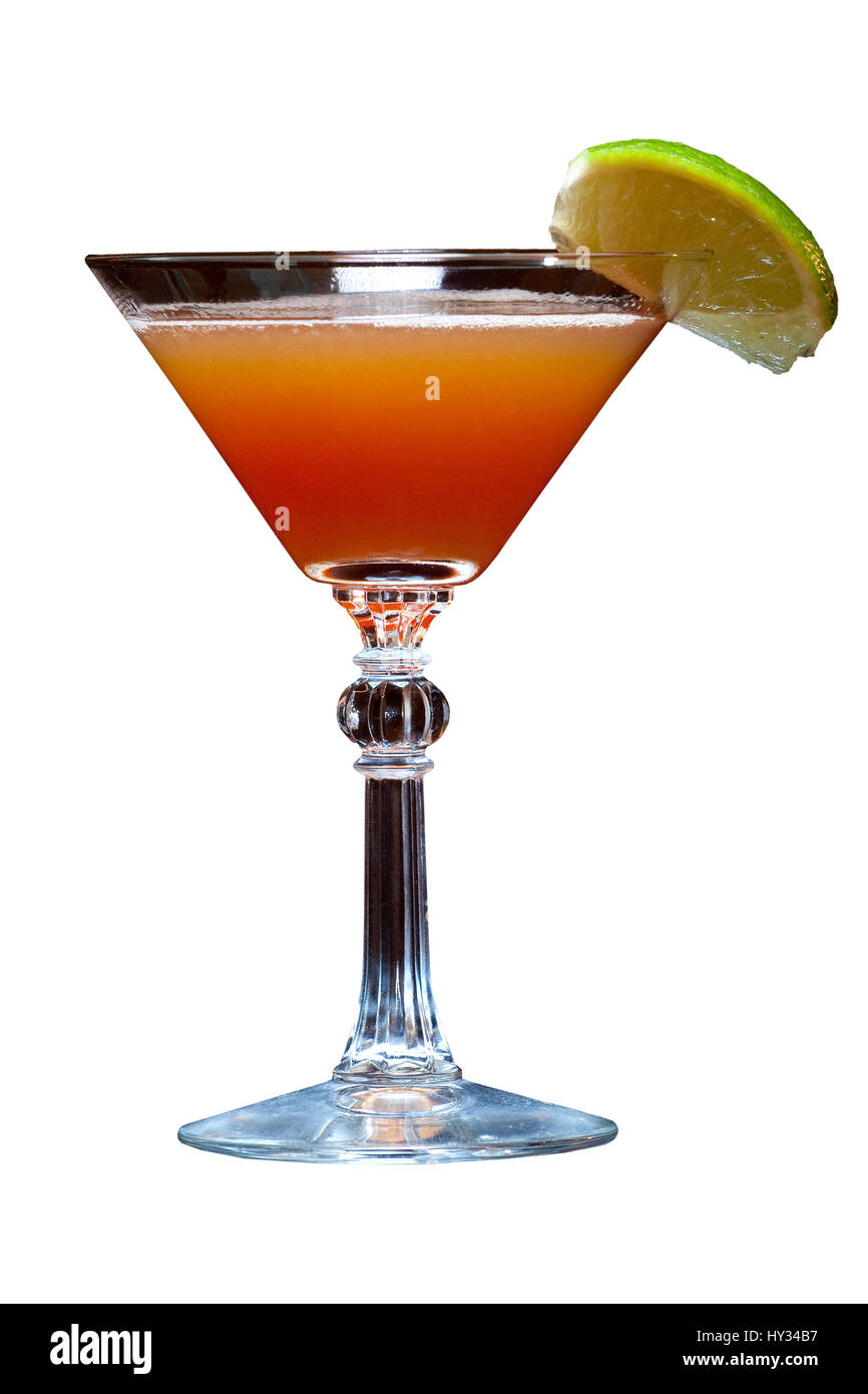 A Pink Lady in a traditional glass with a lime on the side, on an even white background. Stock Photo