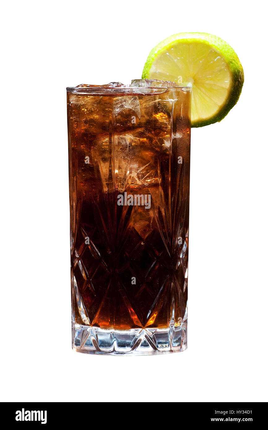 A Cuba Libre - rum, cola and lemon - on a solid white background. - Stock Image