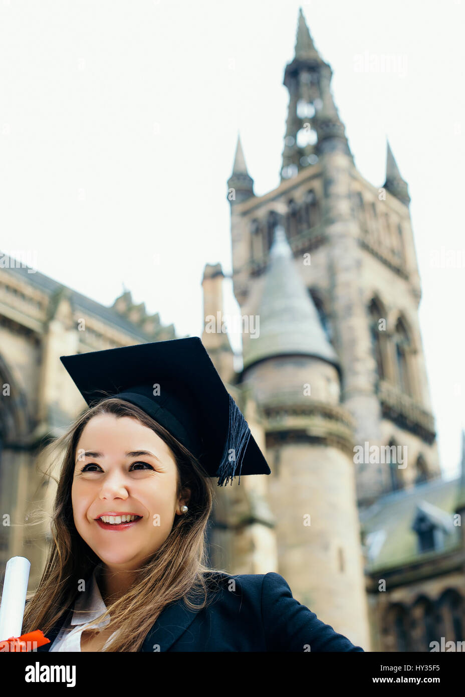 Female Student in Mortar Hat Graduating from Glasgow University - Stock Image