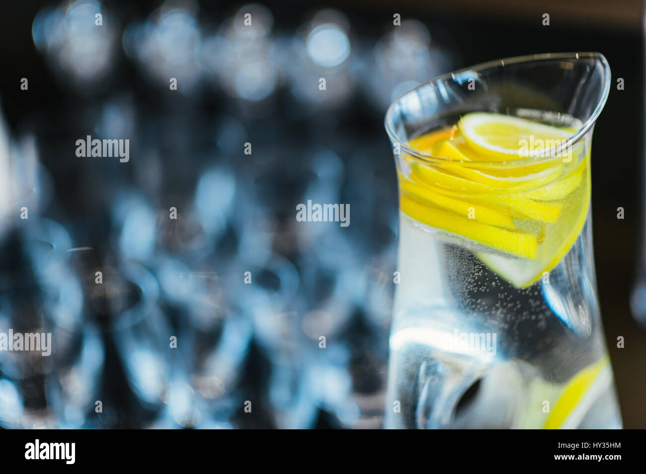 Glass Jug of Fresh Water with Slices of Lemon - Stock Image
