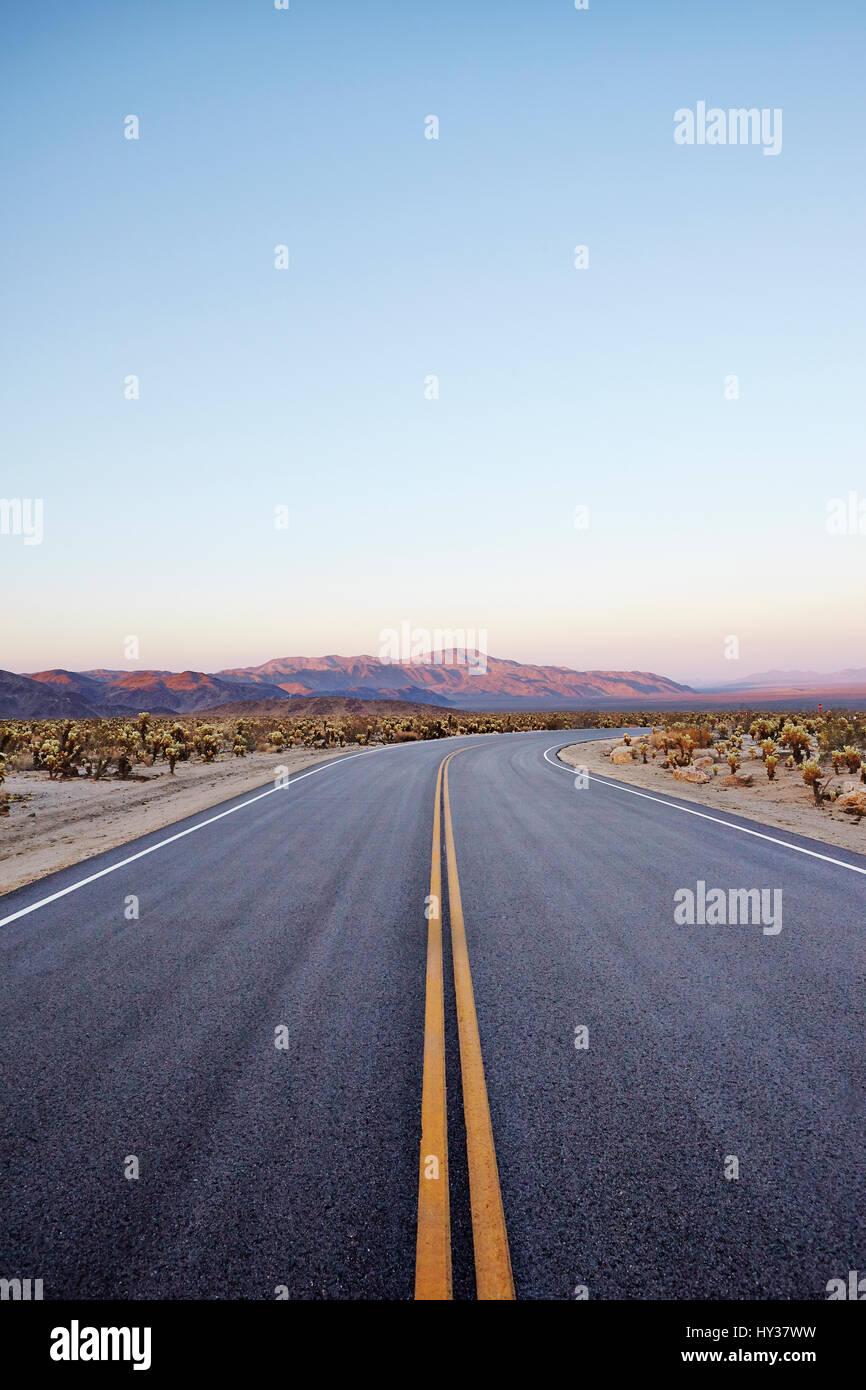 USA, California, Empty desert road - Stock Image