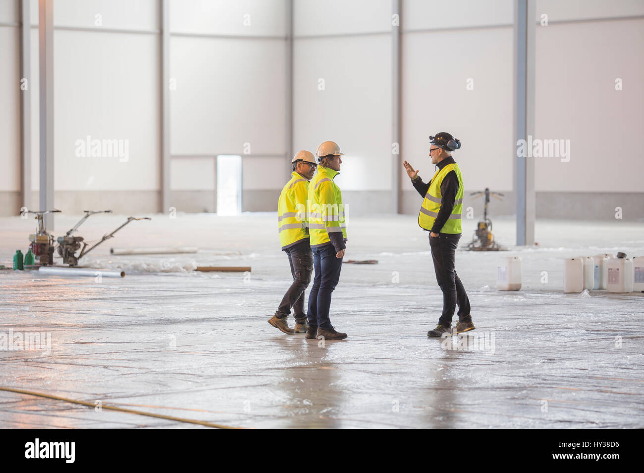 Sweden, Three engineers at work - Stock Image