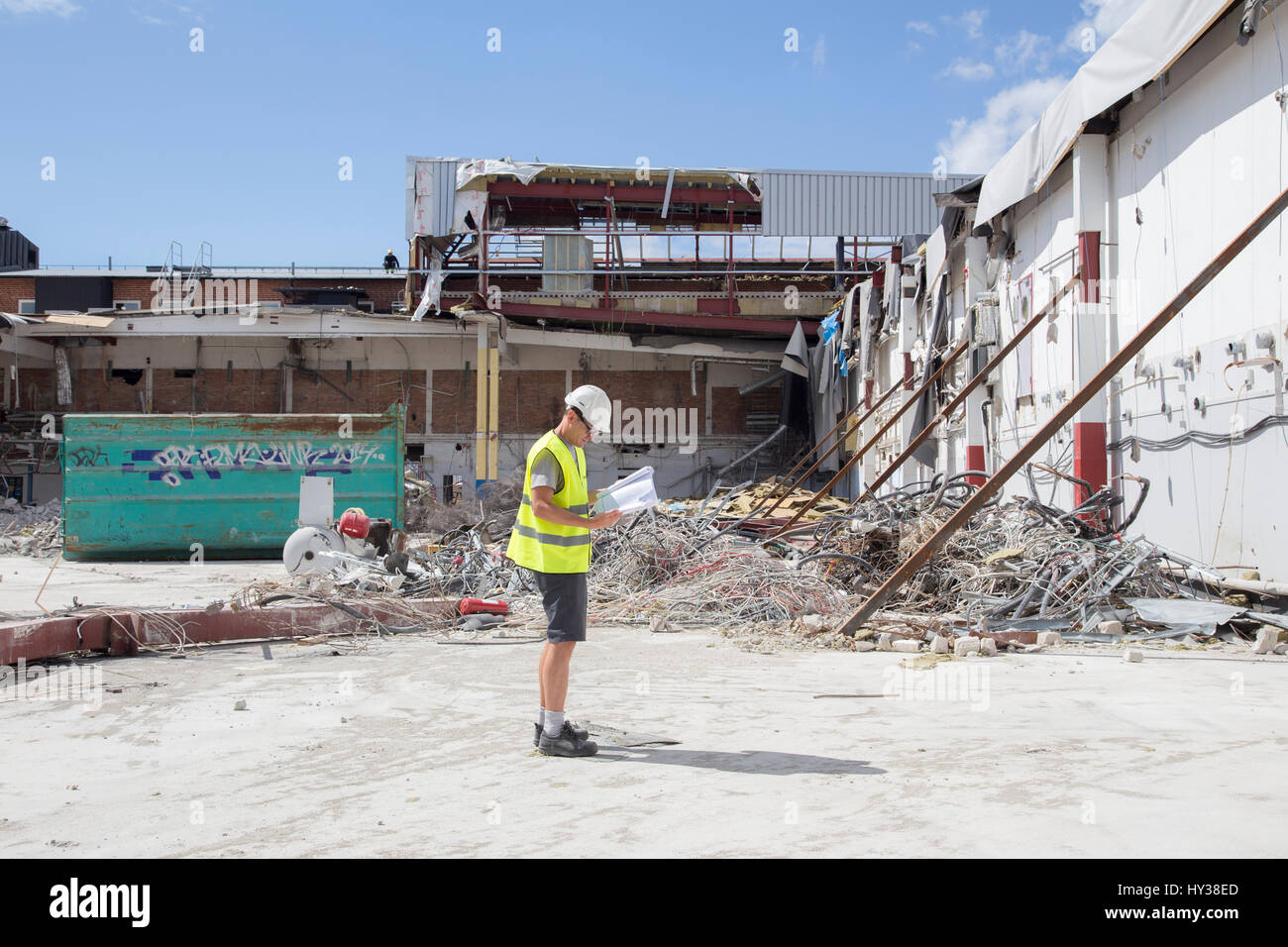 Sweden, Bohuslan, Man reading papers in construction site - Stock Image
