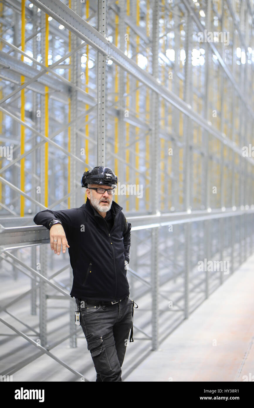 Sweden, Man standing in front of construction - Stock Image