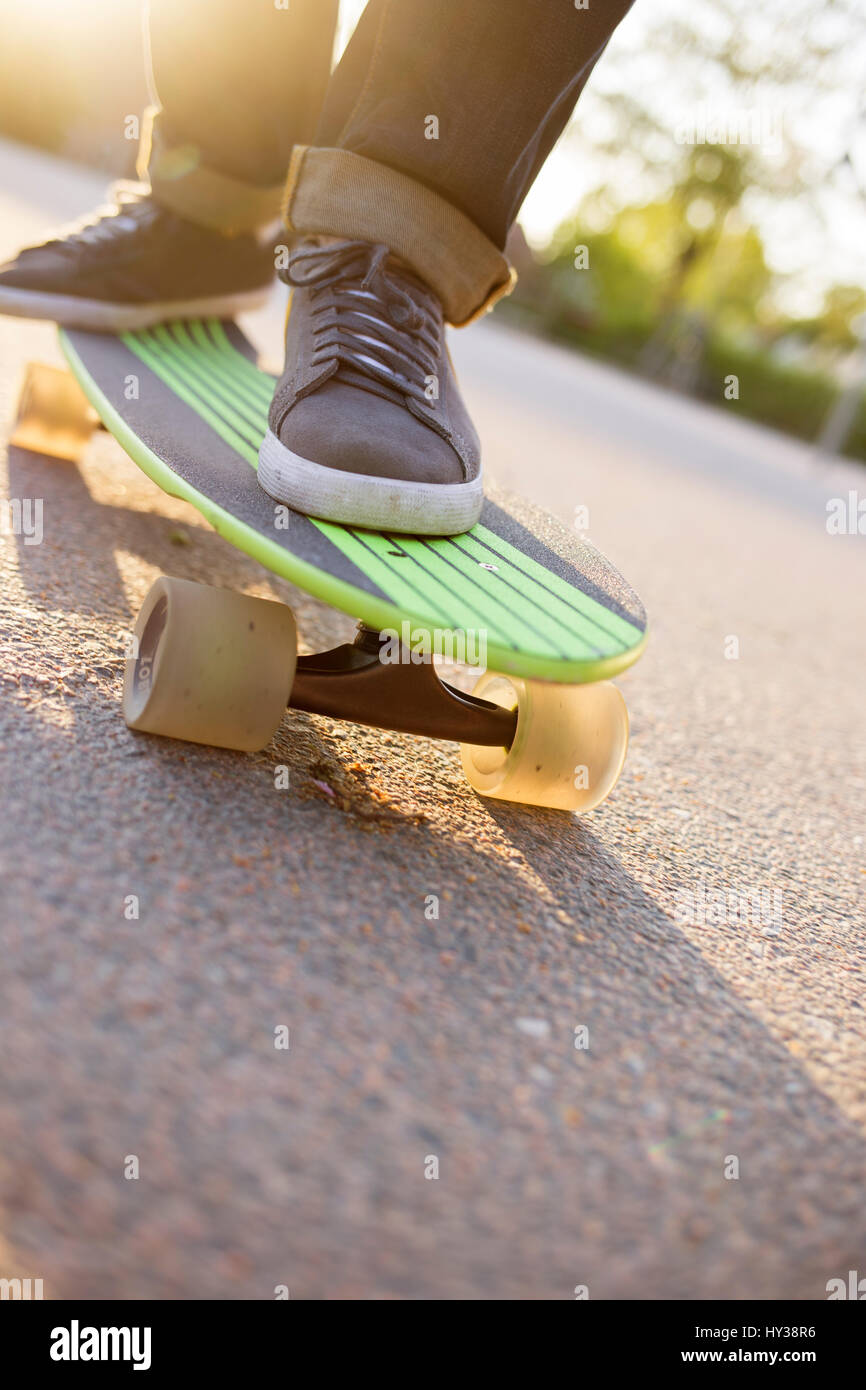 Sweden, Feet of man on skateboard - Stock Image