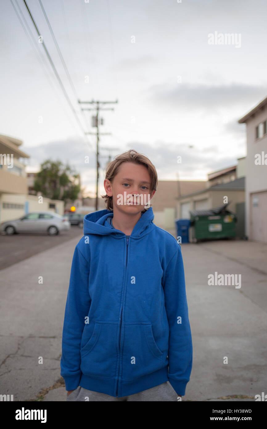 USA, California, San Diego, Portrait of boy (14-15) wearing blue hoodie - Stock Image
