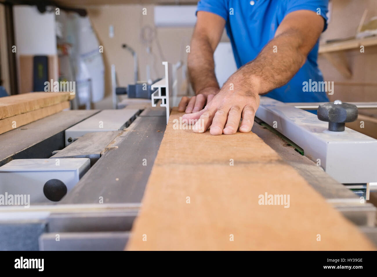 Sweden, Carpenter working with wood - Stock Image