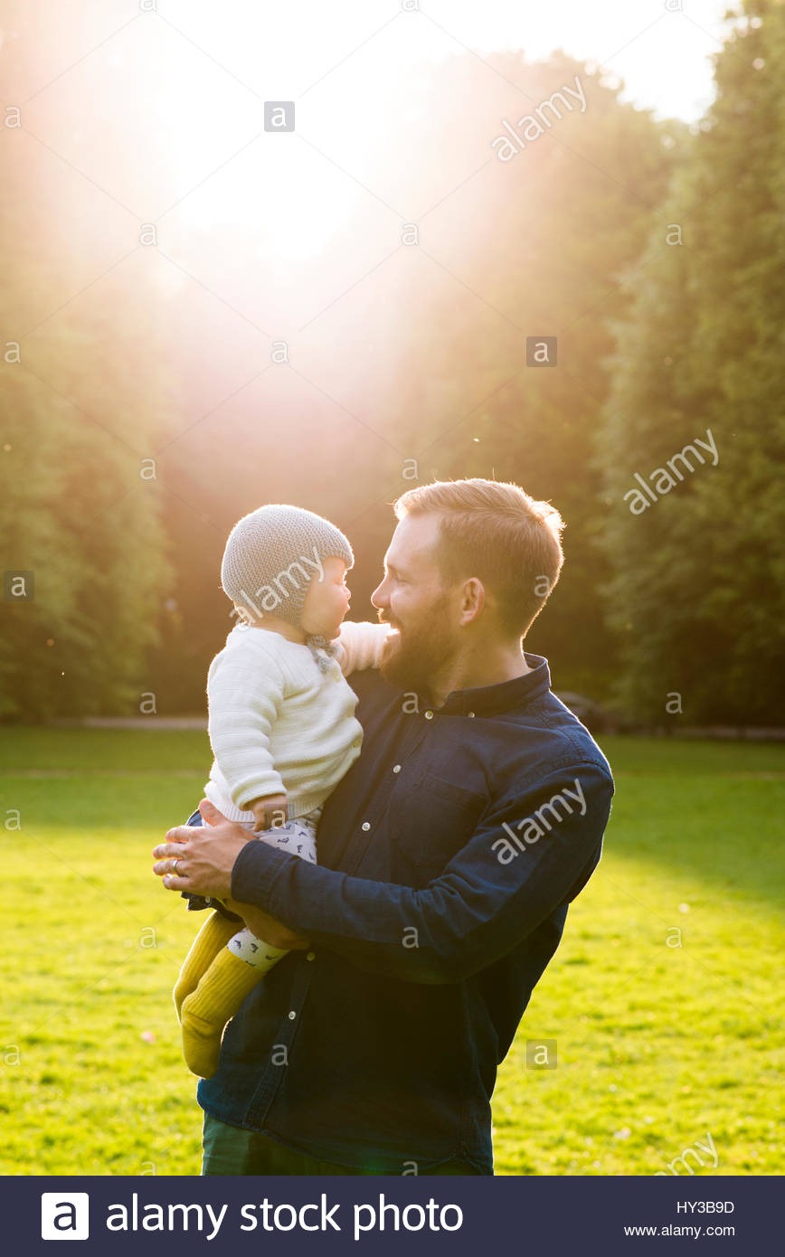 Sweden, Skane, Malmo, Father holding son (18-23 months) in park - Stock Image