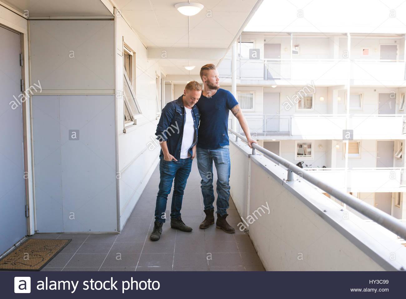 Norway, Oslo, Couple standing on balcony - Stock Image