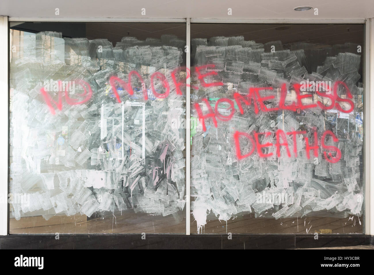 No more homeless deaths written on the windows of closed empty bhs building in Glasgow city centre - Stock Image