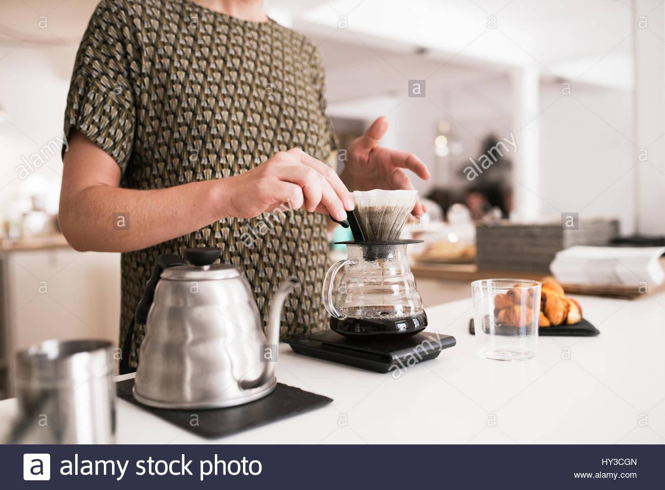 Portugal, Woman preparing coffee - Stock Image