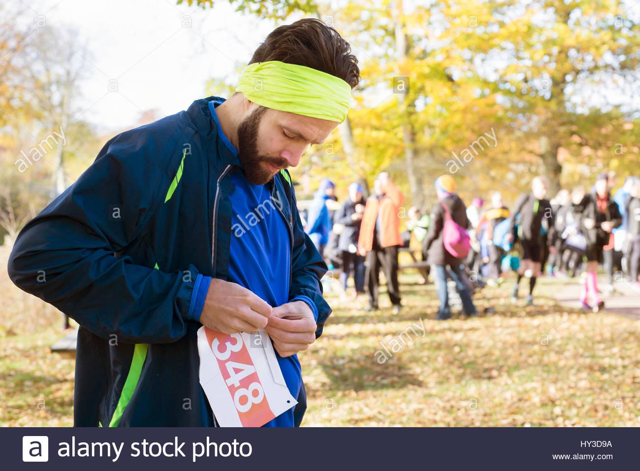 Sweden, Man wearing sports clothing preparing to race - Stock Image