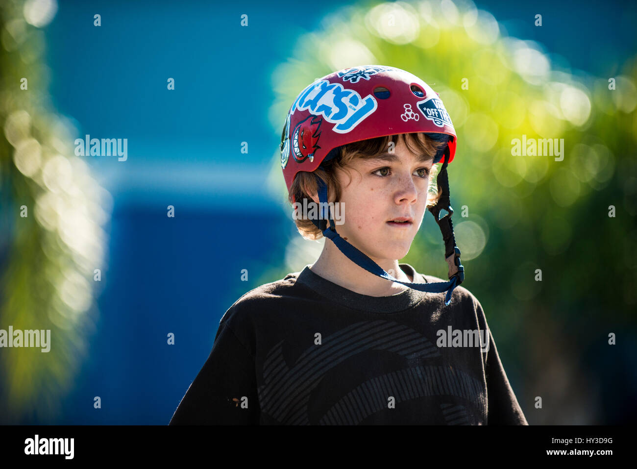 young boy on skate board closeup face - Stock Image