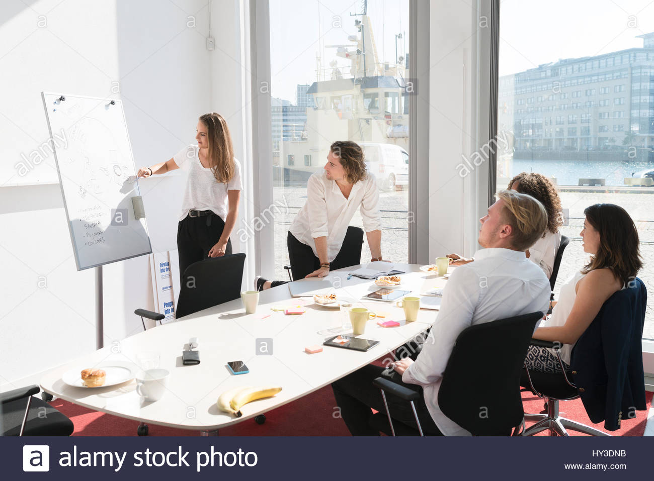 Sweden, Businesswoman giving presentation in office - Stock Image