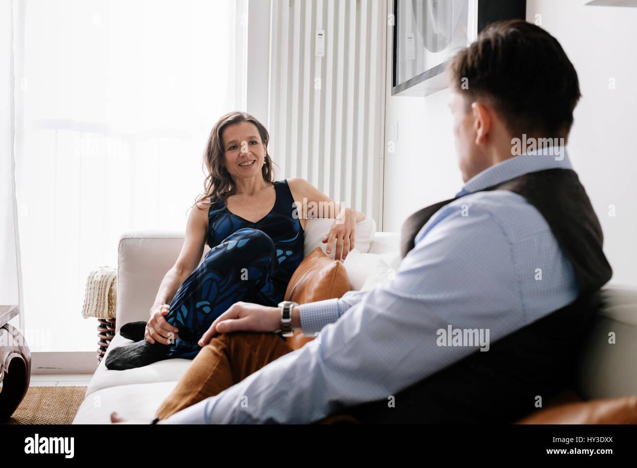 Germany, Couple sitting on sofa - Stock Image