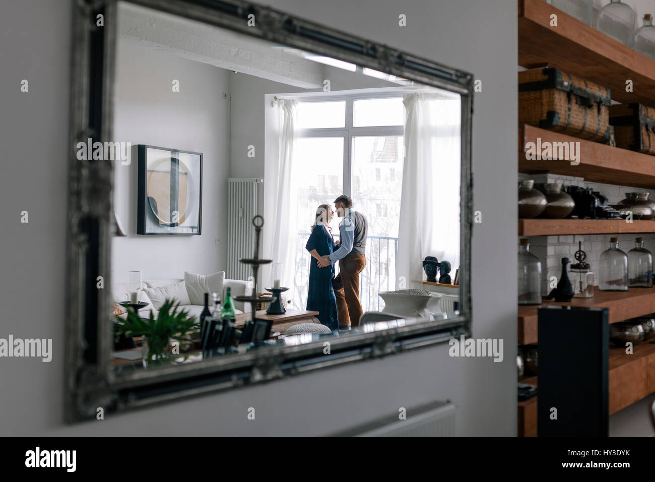 Germany, Couple reflected in mirror - Stock Image