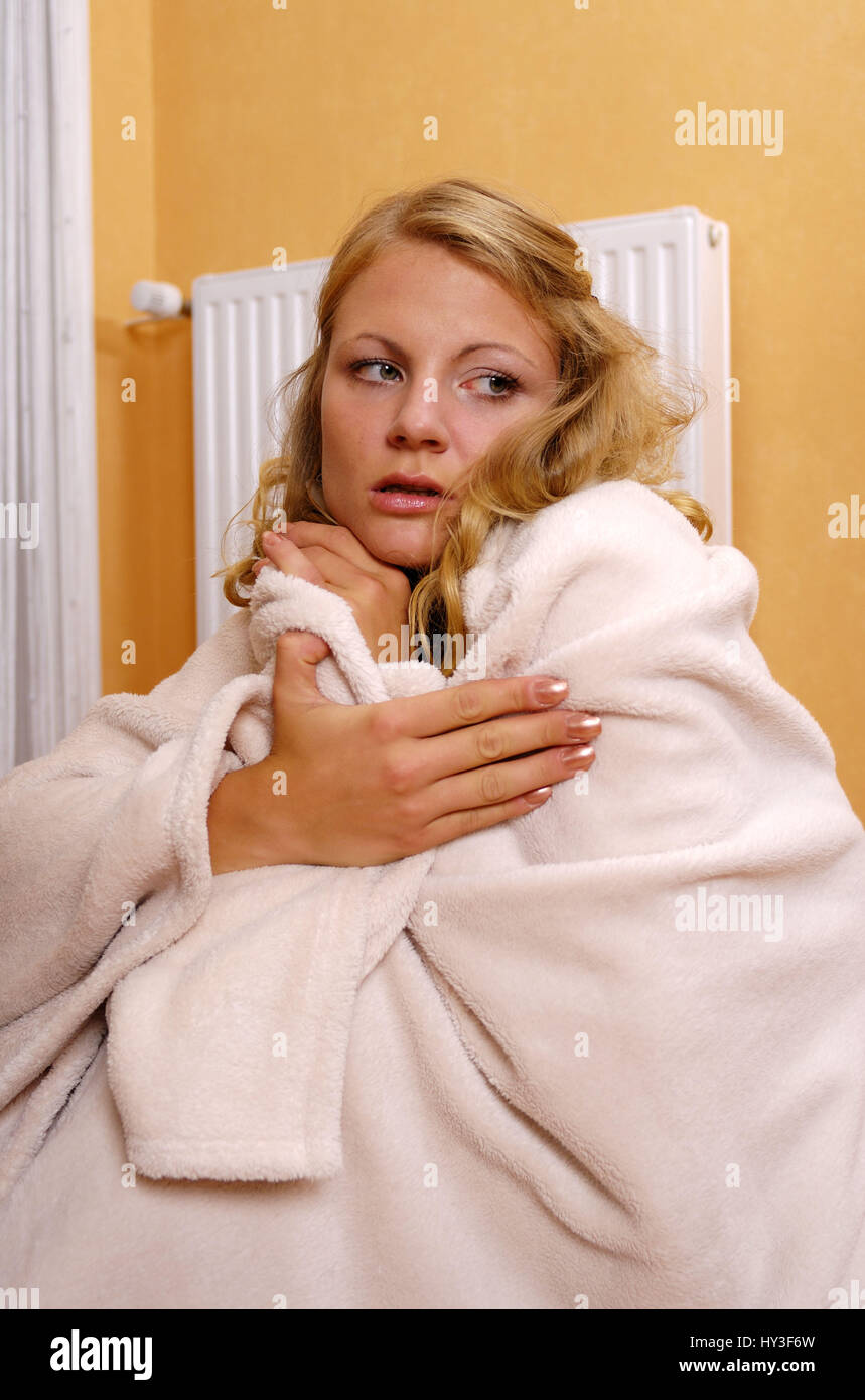 Woman, women, freezes, freezing, heating, , Frau, Frauen, friert, frierend, Heizung - Stock Image
