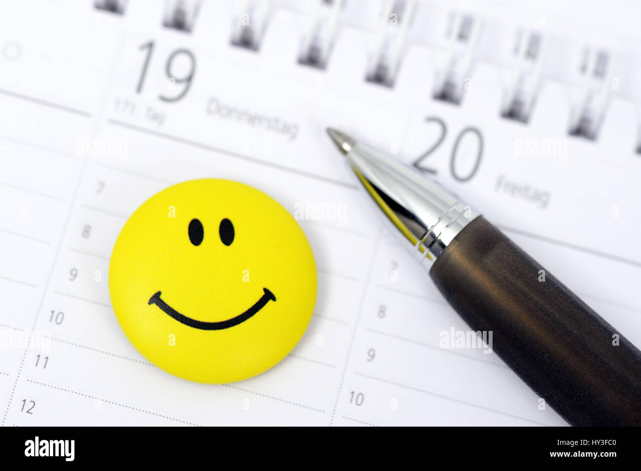 Appointment calendar with Smiley, successful appointment, Terminkalender mit Smiley, erfolgreicher Termin - Stock Image