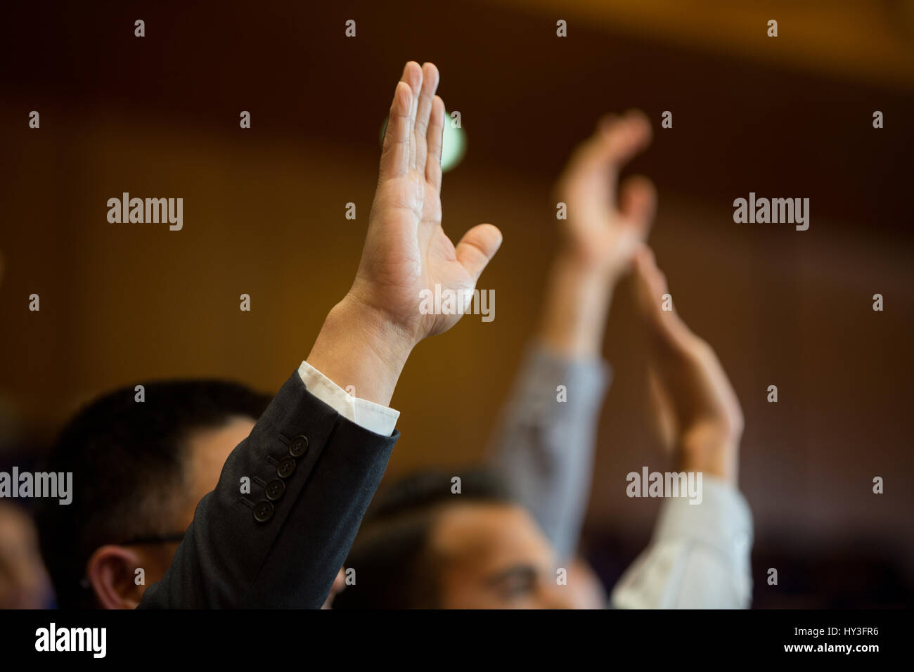 Business executives actively participating in conference center - Stock Image