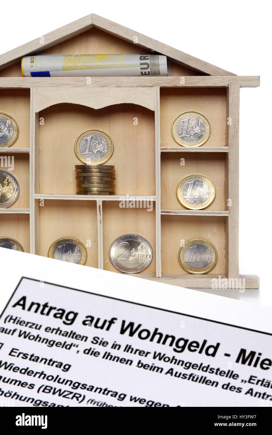 Letter case with euro-coins and application for housing subsidy, Setzkasten mit Euro-Münzen und Antrag auf - Stock Image