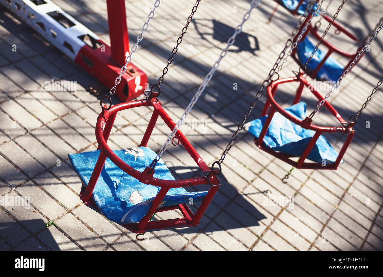Red carousel seats, during spring sunny day. Stock Photo