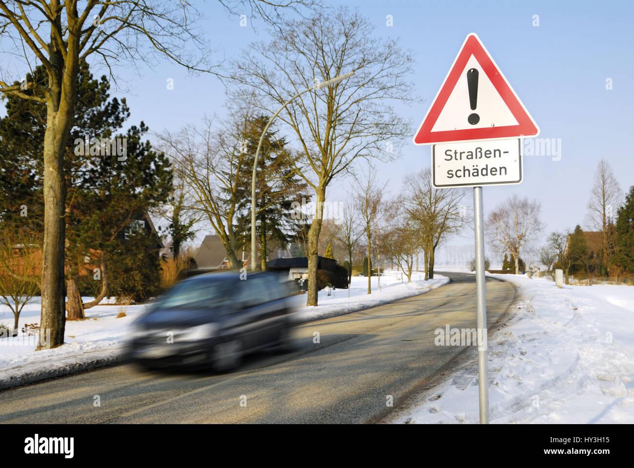 Hard winter: Warning street damages, Harter Winter: Warnschild Straßenschäden Stock Photo