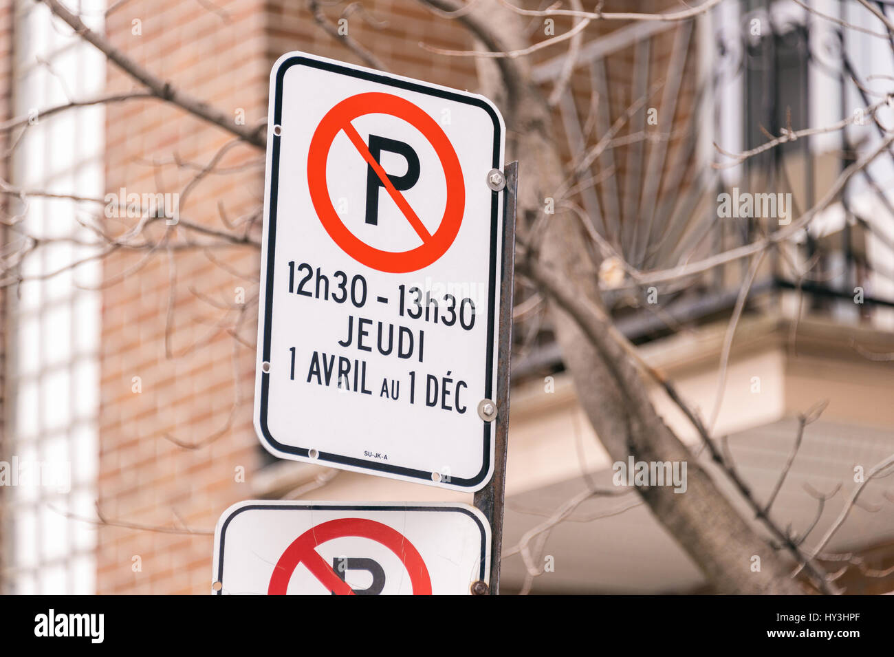 Montreal, CA - 31 March 2017: Street sign showing cleaning Schedule. - Stock Image