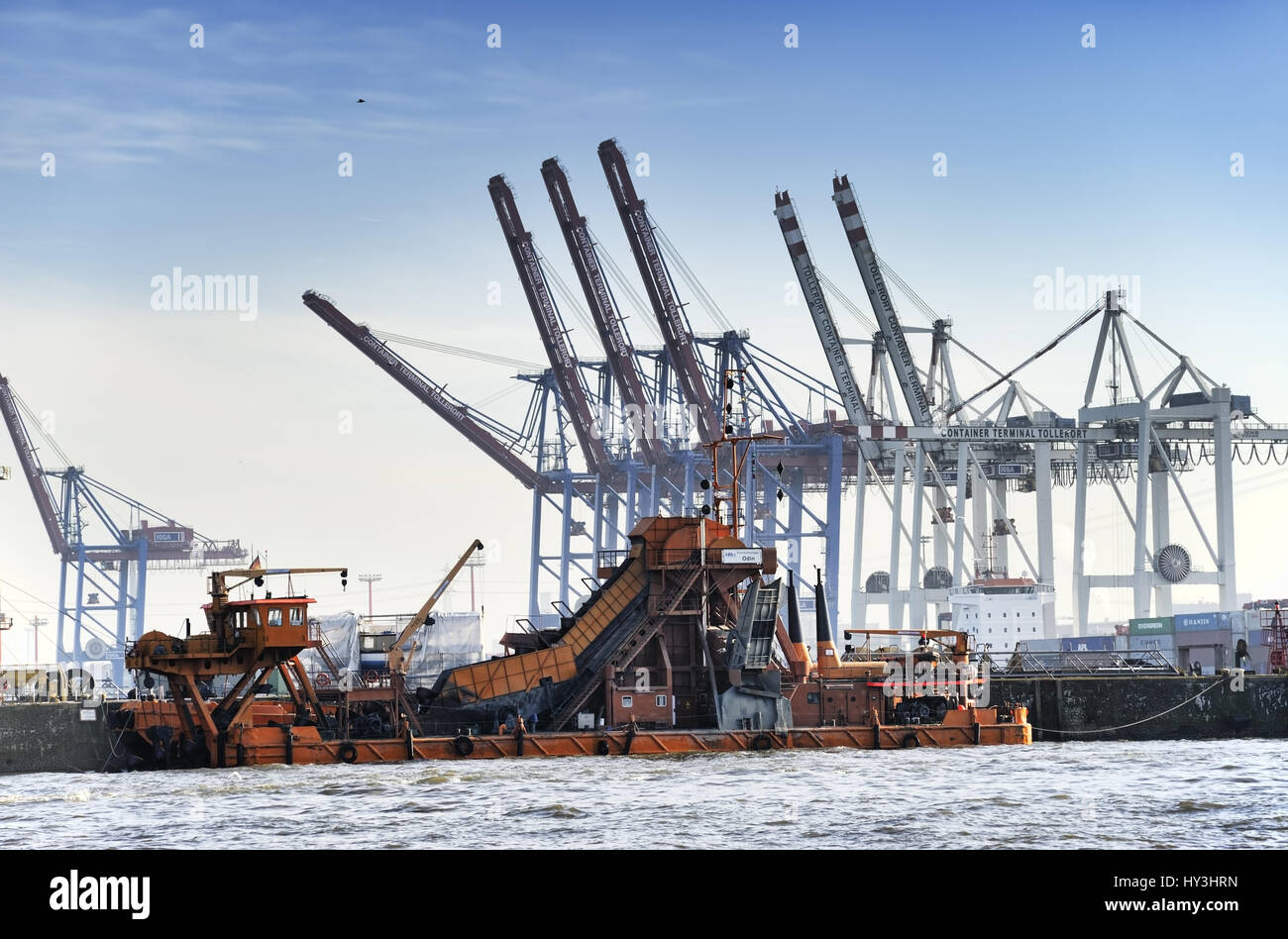 Elbvertiefung: Elbbagger Odin before the great place container terminal in the Hamburg harbour, Hamburg, Germany, Stock Photo